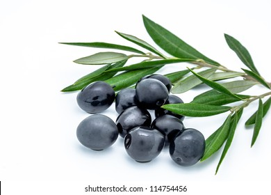 Black olives and olives leaves on a white background