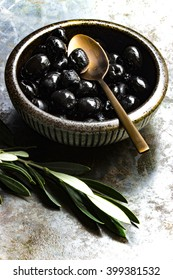 Black Olives in a small Bowl with Spoon