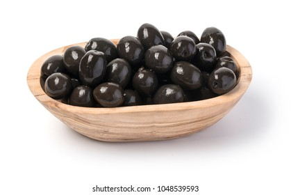 black olives at wooden bowl isolated on white