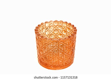 A black orange glass placed on a white background.