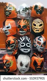 Black and orange Halloween wrestling masks. Vertical.