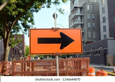 Black and Orange Sign Construction Detour Directional Arrow
