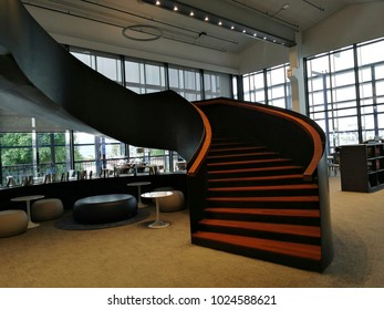 The black and orange stair in the cool office. Interior design.