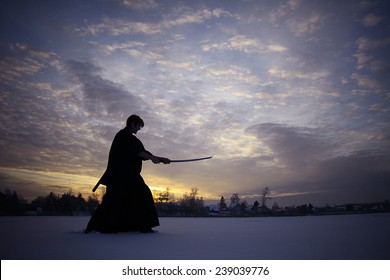 Black oriental martial arts warrior winter training