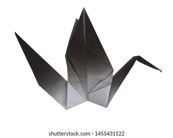 A black origami paper fold in crane shape on white background