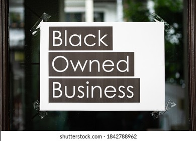 Black owned business sign attached on the window