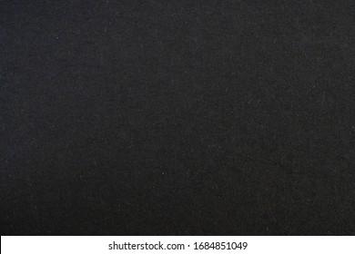 Black paper background. Blank black paper sheet.
