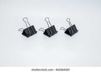 black paper clips isolated who use everyday on a white background