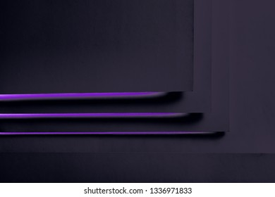 Black paper concept background with violet backlight. Dark geometric layer design with sheets of paper. Flat lay