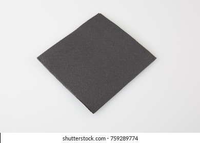 Black paper napkin isolated on white background