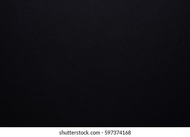 Black paper texture background. Grain texture paper surface in high resolution. Fine arts paper.