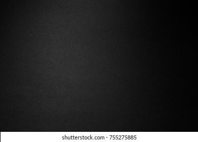 black paper texture or background with spotlight, dark wall backdrop wallpaper, dark tone.