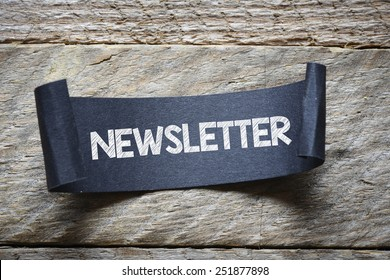 Black papper with newsletter. Black papper with newsletter on wooden background
