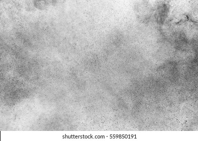 Black particles explosion isolated on white background.  Abstract dust overlay texture