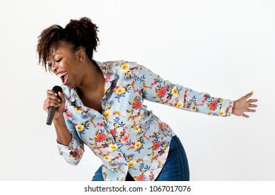 Black passionate woman vocalist singing karaoke