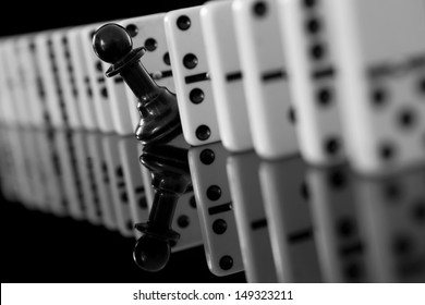 black pawn among domino pieces