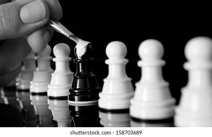 black pawn being painted white as the rest of the pawns