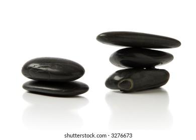 black pebble stone over white background