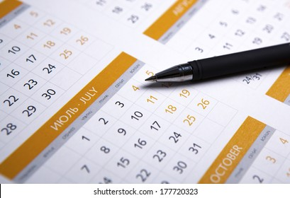 black pen lying on the calendar close-up