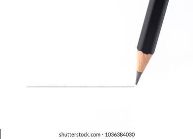 Black pencil drawing a straight line, isolated on white background