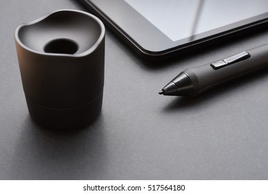 black pencil graphics for tablet and holder for it