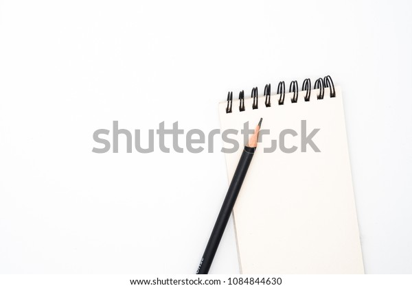 Black pencil with notepad paper isolated on white background