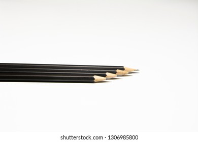 Black pencil on white background.