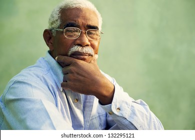 Black people and emotions, portrait of depressed senior man with glasses looking at camera. Copy space