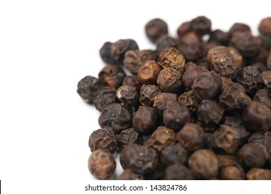 Black pepper corns Scattered isolated on white background.