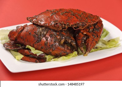 Black pepper crab on white plate