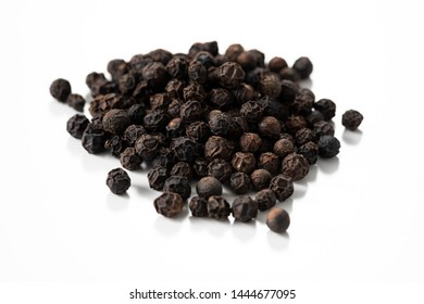 Black pepper, dried and used as a spice and seasoning.