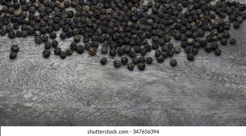 black pepper on old wooden table