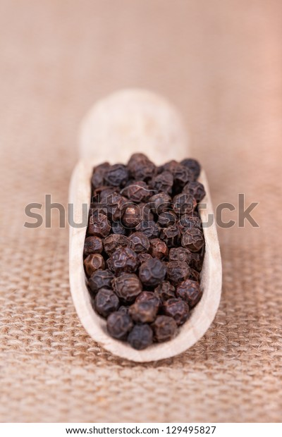 black pepper peas in the scapula against sacking