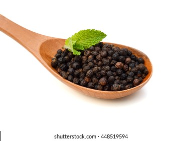 Black pepper was placed in wooden spoon on a white background and isolated