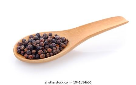 black pepper seeds in wooden spoon
