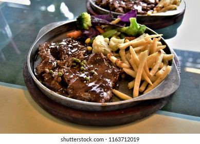 Black pepper steak with brown sauce and french fired on hot plate dish,sizzler,asia food,