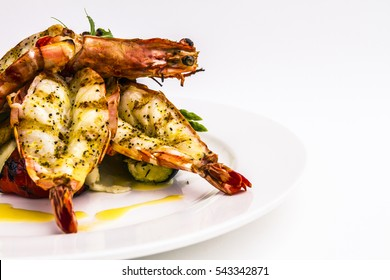 Black pepper tiger prawns on a white plate