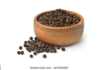 Black peppercorns (Black pepper) in wooden bowl isolated on white background.