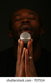 black person and microphone