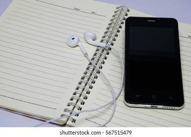 Black phone and white book