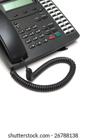 Black phone with a wire on a white background