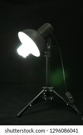 black photgraphy table lamp with photo bulb on black background isolated
