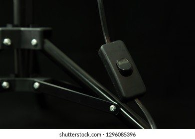 black photgraphy table lamp switch on black background isolated