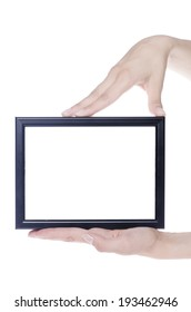 Black photo frame in hands isolated on white background