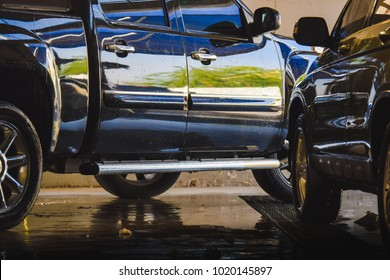 Black pick up truck side view after body wash