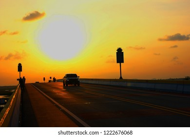 black pickup car drive on highway with sun set sky background