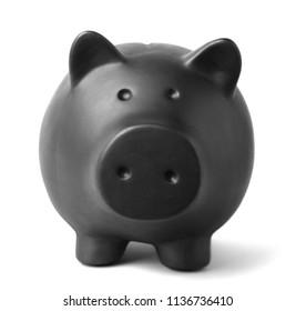 Black piggy bank on gray background. Money saving