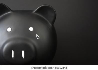 Black Piggy Bank with tear