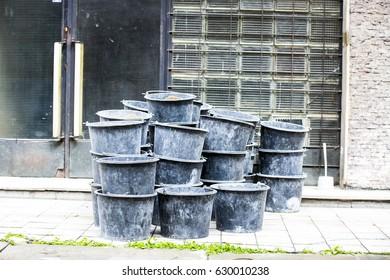 black plastic bucket on a pile