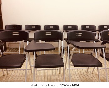Black plastic chairs of a conference unique photo
